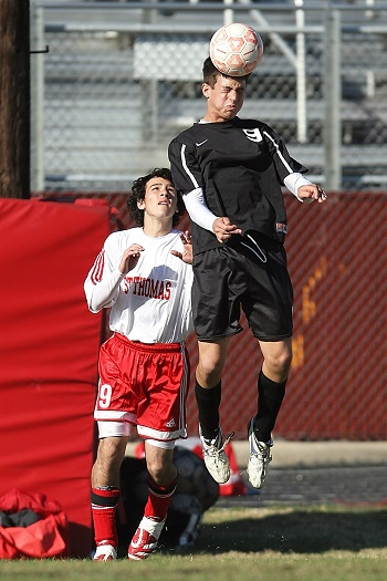 Soccer player jumping up to head the ball receiving large forces to the head and brain.