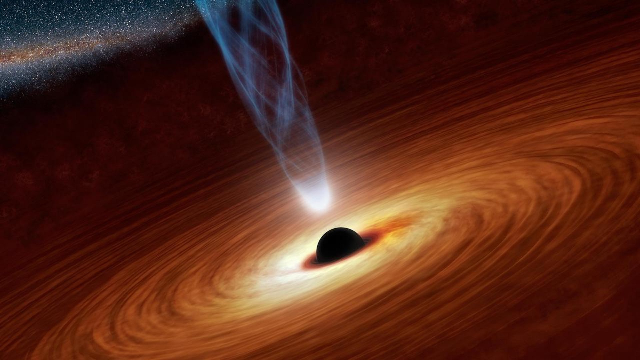 Hungry black hole among the most massive in the Universe