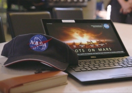 NASA hat and laptop used by the scientists to give students a behind-the-scenes look at what the Perseverance rover will get up to on Mars