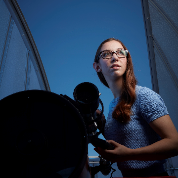 Kirsten Banks with a telescope