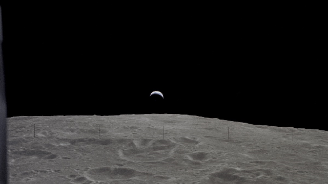 A crest of the Earth is visible above the surface of the Moon