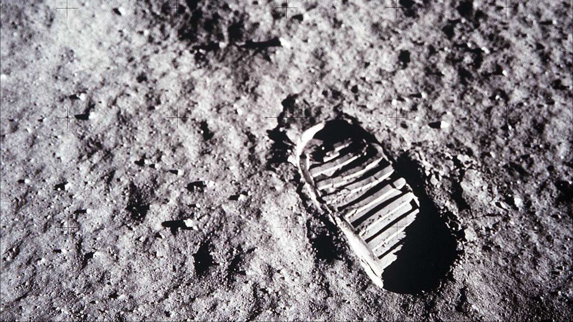 A close up of a bootprint on the Moon