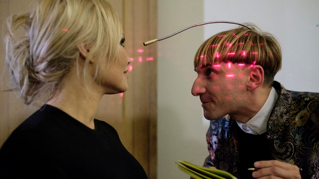 Harbisson is mapping Pamela Andersons face using his antenna