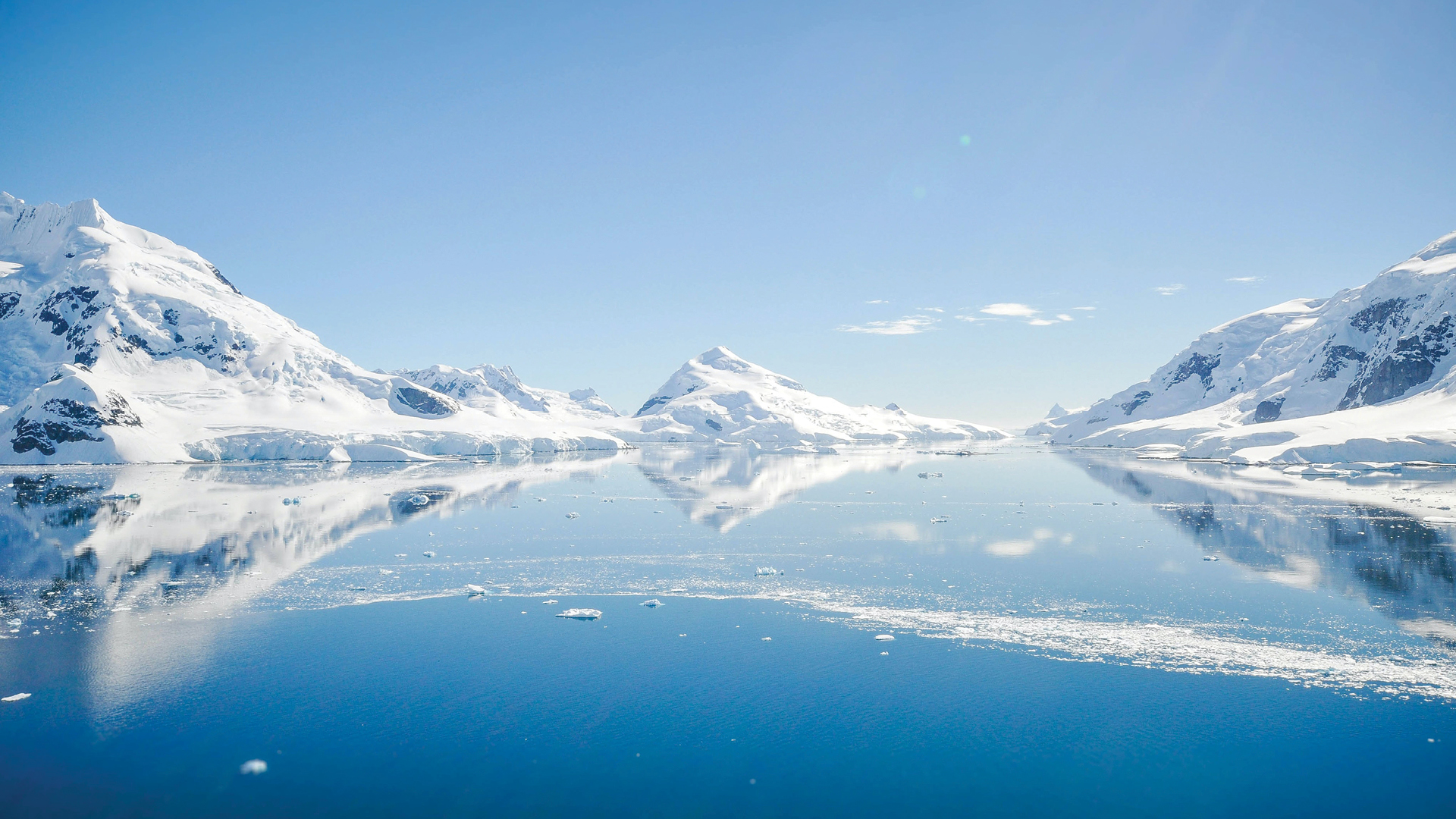 Blue sky, ice and water in Antarctica