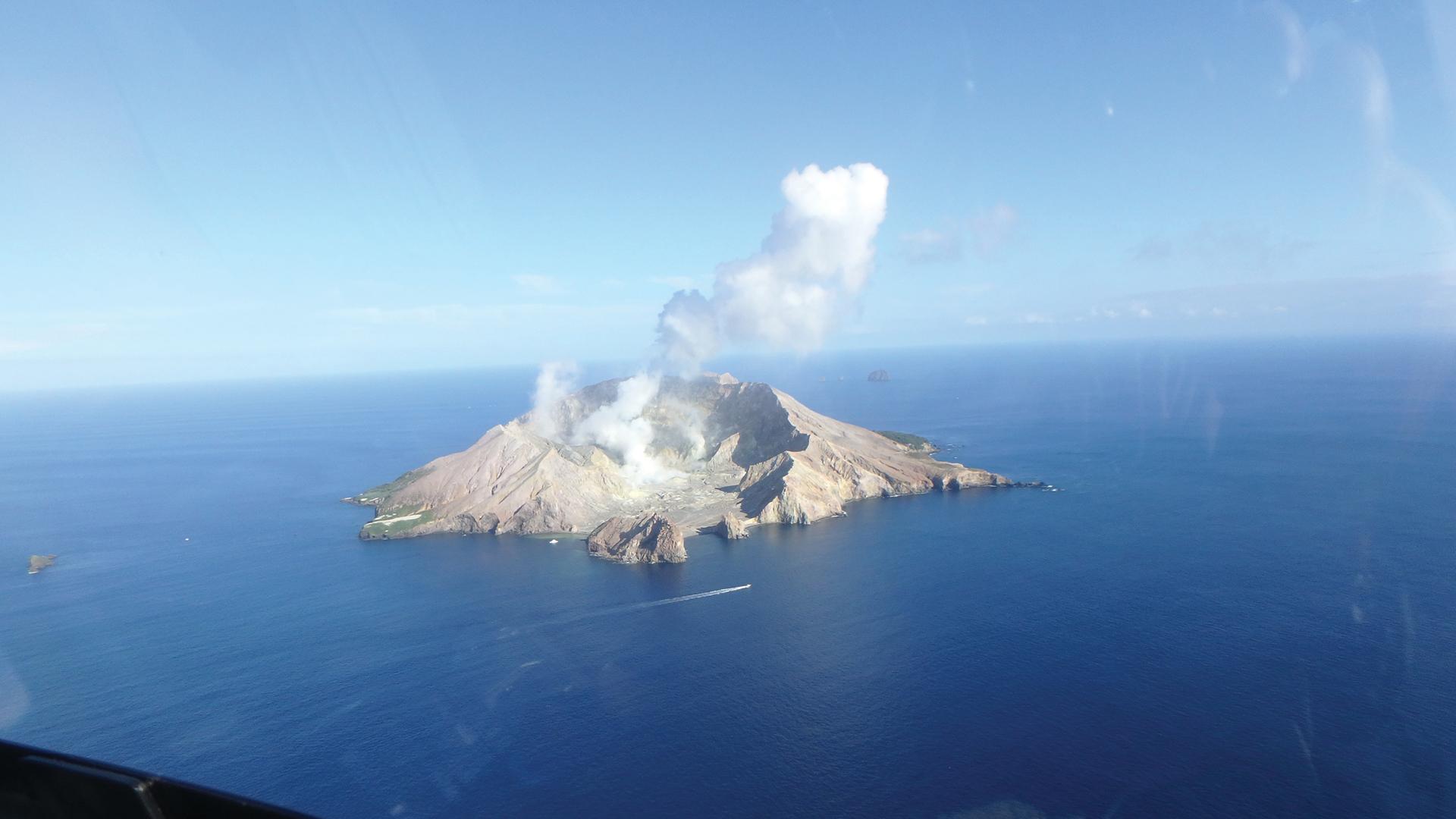 White Island volcano emitting white smoke