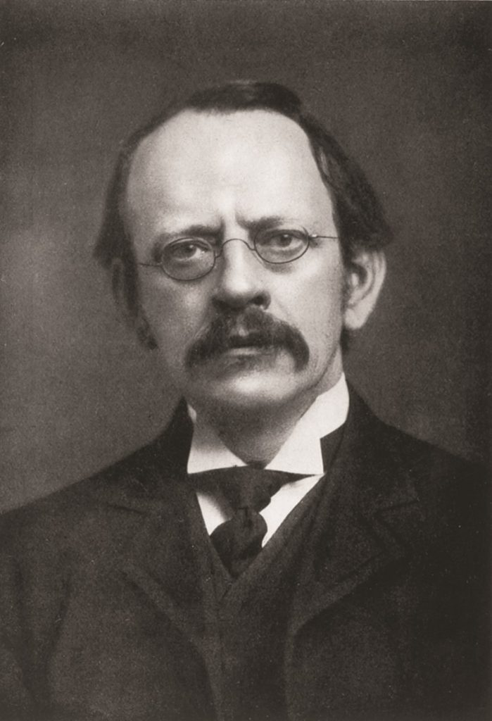 Photograph of JJ Thomson who theorised that atoms were a region of positive charge surrounded by negative charges