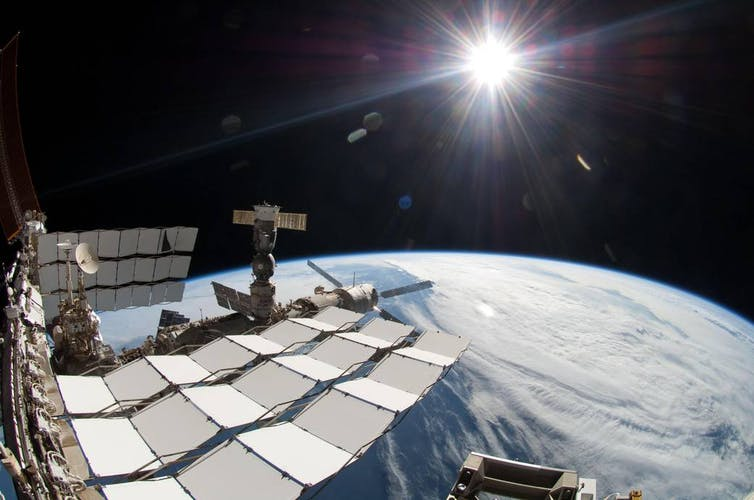 A view of Earth from the International Space Station. The Sun can also be seen in the distance.
