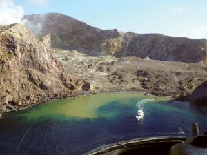 A tour boat crossing the surface of the White Island volcano