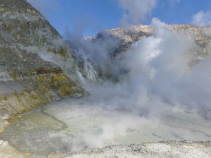 Looking into the White Island volcano as it emits white smoke