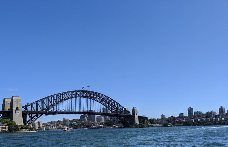 Sydney Harbor Bridge infront for a bright blue sky