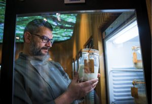 Karl De Smedt looking at one of his sourdough starters in the fridge.