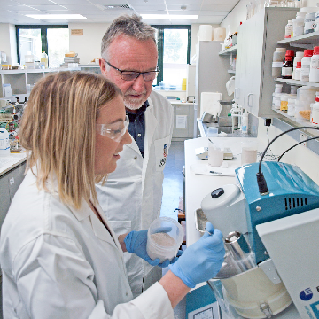 Researchers in a lab examining the concentration of cadmium in soil