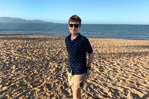 A boy standing on sand with the sea behind him. A clip from the Eureka Prize winning film.